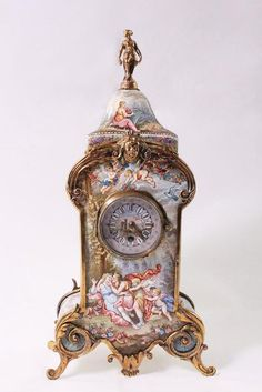 Fine Vienna enamel clock Depicting Lovers under garlands of flowers with cherubs swing from trees with figural finial. Item was passed Flower Head Wreaths, Paper Flower Garlands, Antique Desk, Antique Clocks, Vintage Clocks, Antique Watches, Antique Fairs, Grandfather Clock, Pendant Light Fixtures