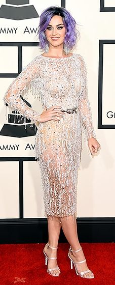"""The """"Dark Horse"""" nominee, who debuted lilac tresses, sparkled in a silver Zuhair Murad dress dripping with beaded fringe, plus nude satin Sophia Webster heels."""