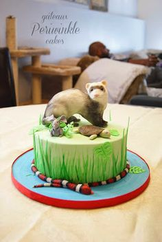 Critter cake featuring a rice crispy ferret