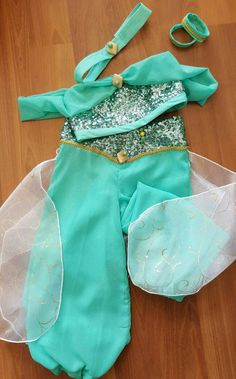 Princess Jasmine - sweet , sparkly and very regal. The costume includes: sparkly crop too with sash and beading details. Harem style pants with a veil. Headband and hairties