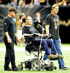 Former Saint Steve Gleason (center, with coach Sean Payton and ex-teammate Scott Fujita) has made a home in New Orleans. (Stacy Revere/Getty...
