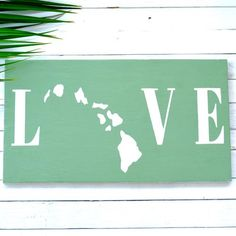 Our Island Love Wooden Sign is inspired by the Aloha spirit to fit any lifestyle using reclaimed, repurposed wood from Hawaii. Hand cut, sanded, painted up-cycled wood and then dried on our lanai by the Hawaiian Sun.  DIMENSIONS: This product is 23 inches in length, 11 inches in height, and is 3/4 inches in width.  #HawaiiLove #homedecor #beachdecor #hawaii #handmade #customsign #hawaiisign #beachsign