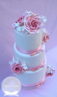 Rose wedding cake. I really like this. Instead of pink maybe silver accent, white Roses with bling
