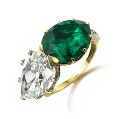 An Colombian Pear-shaped Emerald and Pear-shaped Diamond Twin Stone Ring, by Tiffany & Co., circa 1915