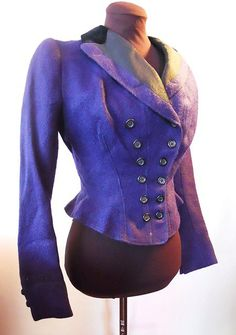 Cobalt blue Victorian wool jacket. Double breasted, nipped waist, weighted silk and velvet black lapel.