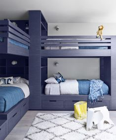 This room in a Silicon Valley family home features custom-made bunk beds, bedding by John Robshaw and pillows by Jonathan Adler. The shag rug is by NuLoom, and the flooring is walnut.