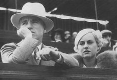 Charlie Chaplin and a blonde Paulette Goddard, attend a Tennis Tournament. This was shortly after they met in July, 1932.