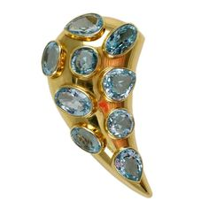 An oval Aquamarine gold set Cornucopia pin of wonderful proportion by Solange Azagurry Partridge.