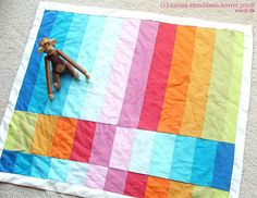Beautiful rainbow inspired baby quilt, love the pattern
