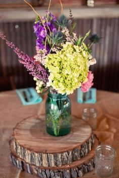 Rustic Wedding Centerpiece with vintage blue Ball mason jars and flowers
