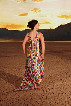 """Casino Chip Dress"" is made by Robin Barcus of over 2000 casino chips, each with 6 drill holes joined by clear zip ties."