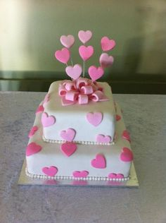 A wedding cake I made in December 2012. Light fruit cake with fondant icing.
