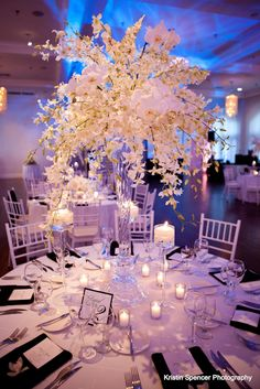 """""""I could not be happier with my choice to use stoneblossom florists! Joyce the owner and creative genius brought the vision of my wedding to fruition and I was blown away when I walked into the room at Belle Mer in Newport RI. I chose all white flowers in various textures and brought pictures from magazines that I likes, not only did she replicate them she made them even better!!!"""""""