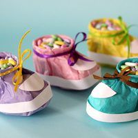 If you're looking for an adorable party favor for a baby shower, these baby booties are a perfect fit. Made of tissue paper and a small paper cup, they can be assembled in just a few minutes. Create an assortment in various colors or match it to your shower's color scheme.