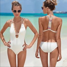 New S monokini swimsuit New in package condition. Size small. Removable padded bust. Plunge neckline. Print  detail. Swim One Pieces