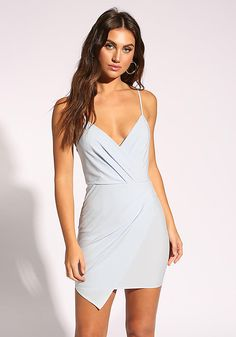 148d61d42f A gorgeous bodycon dress in a woven bodice solid all throughout. Features a  pleated layered front with a plunge neckline and spaghetti straps.
