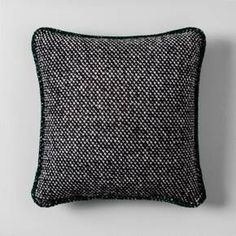 Add a decorative dose of contrast to your decor with the Knit Wool Throw Pillow from Hearth & Hand™ with Magnolia. You'll love the knit texture and versatility of this black-and-white throw pillow, as it can easily blend in with all of your existing decor. It's the perfect accent piece to place on top of your living room sofa or a comfy reading chair, or to mix in with other throw pillows on your bed.<br><br>Celebrate the everyday with Hearth & Hand &m... #PillowOnBed