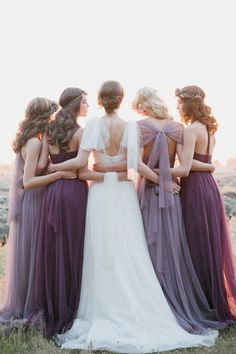 Convertible bridal gowns and bridesmaid dresses by @Jenny Yoo have our hearts going pitter pat!  Would you consider one?  Who's having a purple wedding party?  Photo by @modernromance