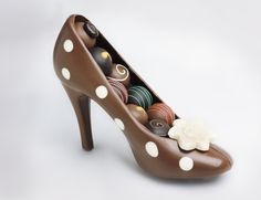 Milk Chocolate High Heel Shoe. Milk Chocolate High Heel Shoe 39$ here, but a 3D high heel mold for chocolate is only 3.99 at Amazon.com, these would be great as treats on the table for women's meetings.
