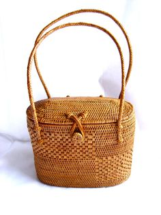 Beautifully Patterned Woven Handbag with Braided Straps and Twisted Woven Loop Closure.  A Classic Reminiscent of Nantucket Baskets.  Will Last for Years!  From the Dixie Reinhardt Collection.