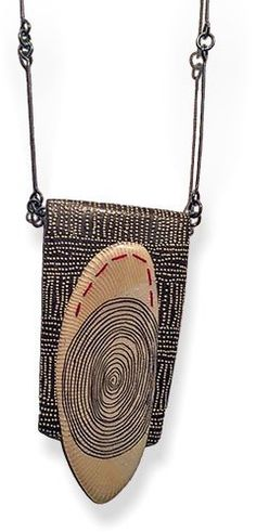 "Kathleen Dustin's ""Tribal Queen"" pendant.  Found on Polymer Clay Daily Polymer art curated by Cynthia Tinapple"