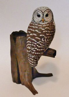 Tim McEachern - Owls carved out of a wood block