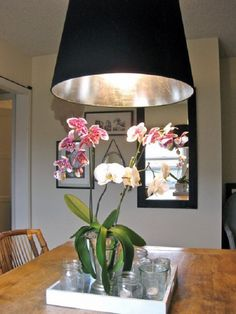 Tips to make your Ikea furniture look expensive ....  applying silver leaf inside your lampshade