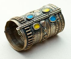 Afghanistan | Antique Turkomen bracelet.  Metal, fire-gilt, with glass stones | ca. early 1900s | 235$