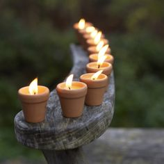 Votive candles in little clay pots