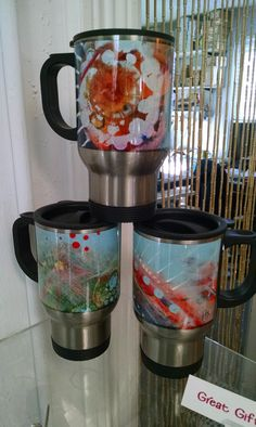 Stainless steel travel mugs w/original artwork by PatriciaDee. Perfect stocking stuffer for the discerning commuters on your list! Only $18 at Image Awards, Engraving & Creative Keepsakes, Inc.