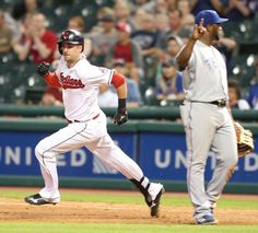 Cleveland Indians Lonnie Chisenhall rounds first base with a lead off double in the 11th inning against the Texas Rangers at Progressive Field on June 1, 2016.  (Chuck Crow/The Plain Dealer)