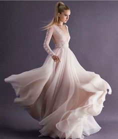 Show your inner elegant and romantic side with this beautiful gown by @paolo_sebastian! Aside from the choice of blush shade, we can't take our eyes off from the flowy sheer skirt and chic lace detailing on this long sleeve dress, accentuating a posh and sophisticated vibe. Isn't this piece a stunning one? Tag a friend to share the inspiration!