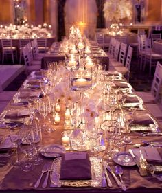 love the long banquet tables with candles and low floral