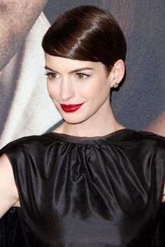 Anne Hathaway. See the 33 other best celebrity pixie cuts in history.