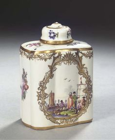 A Meissen porcelain lobed rectangular tea caddy and cover -  1740-1745, BLUE CROSSED SWORDS MARK AND GILDER'S A.  - After a silver model, decorated with trade scenes or Kauffahrteiszenen within elaborate gilt strapwork cartouches, further with sprays of Holzschnitt flowers, the upper border with a gilt band of garlanded strapwork, with lobed shoulders, gilt upright neck, the domed cover en suite (some regilding)  11.8 cm. high (2)