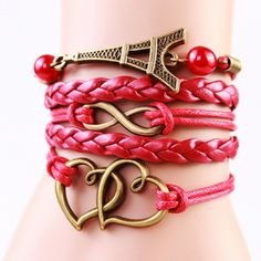 Eiffel Tower Leather Infinity Heart Bracelet: This fun and flirty infinity bracelet is made from red vegan leather and should fit any adult or child sized wrist from 7 - 9 inches. If you're looking to add something unique to your jewelry collection then this piece would make a perfect addition! It's crafted with lobster claw clasps and lengthening chain for a reliable and comfortable fit. This is a piece we're sure you'll enjoy everyday!