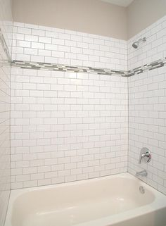 "Contemporary Full Bathroom - Found on Zillow Digs. This tile surround features 3x6 White Ice Brick Laid Subway tile with Deloreon Gray grout. The 3"" glass accent tile is Zumpano Iceland Bliss. Designed and Built by Epic Development; Photo by OBEO"