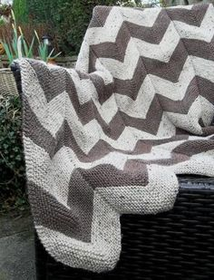 Looking for your next project? You're going to love Aran Garter Stitch Chevron Throw by designer Design Studio. - via @Craftsy