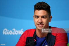Gold Medalist swimmer Anthony Ervin of the USA talks to the media during a press…