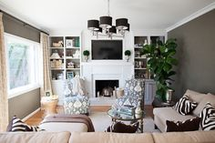 eclectic family room, built in bookcase, bookshelf styling