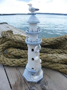 Lighthouse birdhouse.. Direct store at this link: http://www.dorsetgifts.com/lighthouses.html