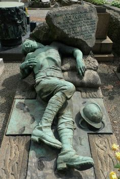 This is a very disturbing cemetery monument! 1896 - October He was a casualty of WWI. His tombstone is located in the Cimitero Monumentale de Milano in Milan, Italy. Cemetery Monuments, Cemetery Statues, Cemetery Headstones, Old Cemeteries, Cemetery Art, Graveyards, Angel Statues, Unusual Headstones, Cemetery Angels