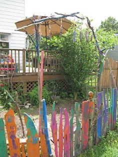 Our beautiful school garden, arch built by the children and fence painted bright and beautiful, what plant wouldn't want to grow here.  artandsoulpreschool.blogspot.com