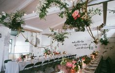 wedding reception with hanging flowers and hanging greenery/folaige. Industrial chairs and table linen. Win A Wedding, Wedding Reception, Wedding Venues, Hanging Flowers, Table Flowers, Flowers Garden, Purple Flowers, Colorful Flowers, White Flowers