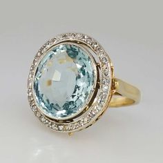 Shimmering 1940s Aquamarine & Diamond Halo Art Deco Ring | Antique & Estate Jewelry | Jewelry Finds