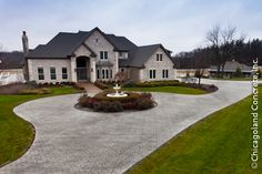 Google Image Result for http://www.chicagolandconcrete.com/wp-content/uploads/Stamped-Concrete-Driveway-Circle-Drive-Main-Entrance.jpg