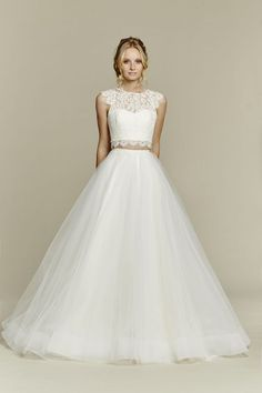 2 piece bridal gowns: An absolute stunner from Blush by Hayley Paige, this bridal two piece ball gown has the cutest, lacy crop top with a pretty keyhole back. And how darling is that scalloped lace at the waist?