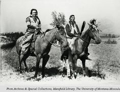 Paul and Den-a-lu (Spokanes). Two Native American men on horses.  Photographed by Edward H. Boos circa 1900 - 1907