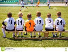 young-football-players-young-soccer-team-sitting-wooden-bench-match-children-boys-playing-tournament-80917081.jpg (1300×992)