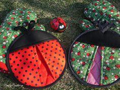 Ladybugs potholders by Carla Cordeiro, via Flickr